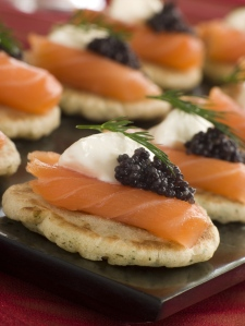 Norwegian smoked salmon blinis with crème fraiche and caviar reduced